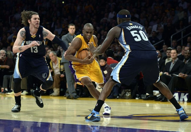 Nov 15, 2013; Los Angeles, CA, USA; Los Angeles Lakers guard Jodie Meeks (center) attempts to drive the ball defended by Memphis Grizzlies forward Mike Miller (left) and forward Zach Randolph (right) during the fourth quarter at Staples Center. The Memphis Grizzlies defeated the Los Angeles Lakers 89-86. Mandatory Credit: Kelvin Kuo-USA TODAY Sports