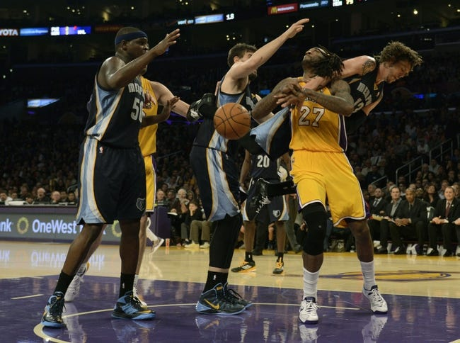 Nov 15, 2013; Los Angeles, CA, USA; Los Angeles Lakers center Jordan Hill (27) gets fouled by Memphis Grizzlies forward Mike Miller (13) while attempting a shot during the fourth quarter at Staples Center. The Memphis Grizzlies defeated the Los Angeles Lakers 89-86. Mandatory Credit: Kelvin Kuo-USA TODAY Sports