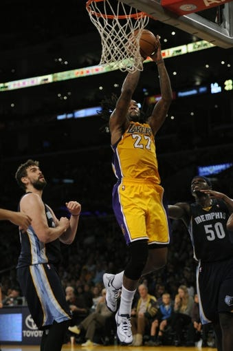 Nov 15, 2013; Los Angeles, CA, USA; Los Angeles Lakers center Jordan Hill (27) goes up for a shot against the Memphis Grizzlies during the third quarter at Staples Center. The Memphis Grizzlies defeated the Los Angeles Lakers 89-86. Mandatory Credit: Kelvin Kuo-USA TODAY Sports