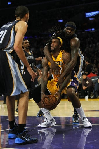 Nov 15, 2013; Los Angeles, CA, USA; Los Angeles Lakers center Jordan Hill (27) is fouled by Memphis Grizzlies forward Zach Randolph (50) during the third quarter at Staples Center. The Memphis Grizzlies defeated the Los Angeles Lakers 89-86. Mandatory Credit: Kelvin Kuo-USA TODAY Sports