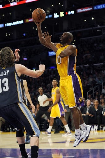 Nov 15, 2013; Los Angeles, CA, USA; Los Angeles Lakers guard Jodie Meeks (20) goes up for a shot against the Memphis Grizzlies during the third quarter at Staples Center. The Memphis Grizzlies defeated the Los Angeles Lakers 89-86. Mandatory Credit: Kelvin Kuo-USA TODAY Sports