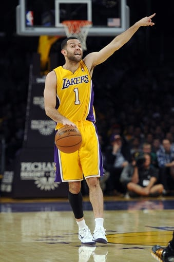 Nov 15, 2013; Los Angeles, CA, USA; Los Angeles Lakers guard Jordan Farmar (1) yells while walking the ball up the court against the Memphis Grizzlies during the third quarter at Staples Center. The Memphis Grizzlies defeated the Los Angeles Lakers 89-86. Mandatory Credit: Kelvin Kuo-USA TODAY Sports