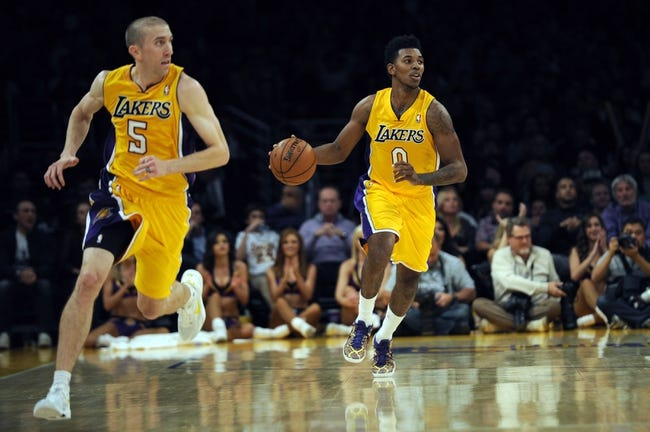 Nov 15, 2013; Los Angeles, CA, USA; Los Angeles Lakers guard Nick Young (0) and guard Steve Blake (5) run up the court against the Memphis Grizzlies during the fourth quarter at Staples Center. The Memphis Grizzlies defeated the Los Angeles Lakers 89-86. Mandatory Credit: Kelvin Kuo-USA TODAY Sports
