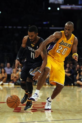 Nov 15, 2013; Los Angeles, CA, USA; Memphis Grizzlies guard Mike Conley (11) steals the ball away from Los Angeles Lakers guard Jodie Meeks (20) during the fourth quarter at Staples Center. The Memphis Grizzlies defeated the Los Angeles Lakers 89-86. Mandatory Credit: Kelvin Kuo-USA TODAY Sports