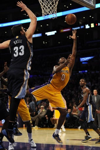 Nov 15, 2013; Los Angeles, CA, USA; Los Angeles Lakers guard Nick Young (0) attempts a shot defended by Memphis Grizzlies center Marc Gasol (33) during the third quarter at Staples Center. The Memphis Grizzlies defeated the Los Angeles Lakers 89-86. Mandatory Credit: Kelvin Kuo-USA TODAY Sports