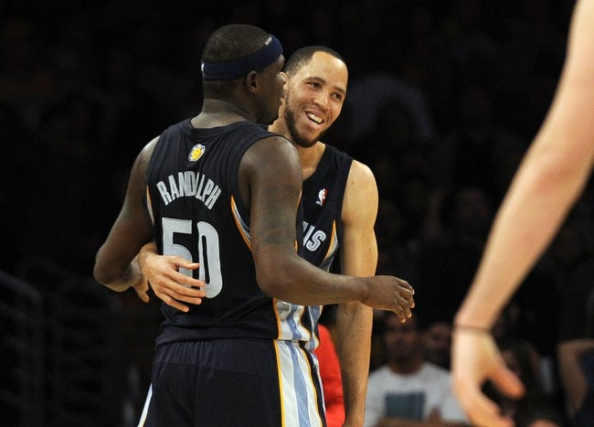 Nov 15, 2013; Los Angeles, CA, USA; Memphis Grizzlies forward Tayshaun Prince (21) laughs after being knocked down by forward Zach Randolph (50) against the Los Angeles Lakers during the third quarter at Staples Center. The Memphis Grizzlies defeated the Los Angeles Lakers 89-86. Mandatory Credit: Kelvin Kuo-USA TODAY Sports