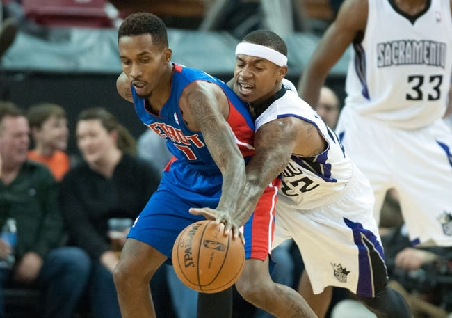 Nov 15, 2013; Sacramento, CA, USA; Sacramento Kings point guard Isaiah Thomas (22, right) attempts to steal the ball from Detroit Pistons point guard Brandon Jennings (7, left) during the fourth quarter at Sleep Train Arena. The Detroit Pistons defeated the Sacramento Kings 97-90. Mandatory Credit: Ed Szczepanski-USA TODAY Sports