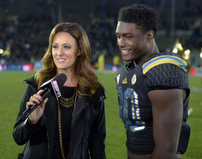 Nov 15, 2013; Pasadena, CA, USA; ESPN reporter Allison Williams (left) interviews UCLA Bruins running back Myles Jack (30) after the game against the Washington Huskies at Rose Bowl. UCLA defeated Washington 41-31.  Mandatory Credit: Kirby Lee-USA TODAY Sports