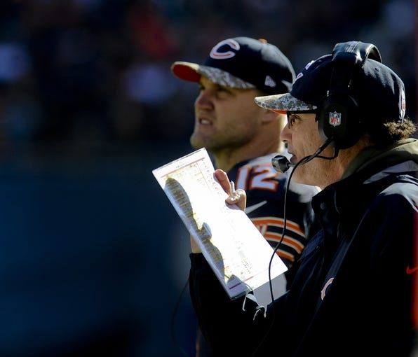 Nov 10, 2013; Chicago, IL, USA; Chicago Bears head coach Marc Trestman and quarterback Josh McCown (12) during the game against the Lions at Soldier Field. Mandatory Credit: Matt Marton-USA TODAY Sports