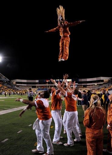 Nov 9, 2013; Morgantown, WV, USA; Texas Longhorns cheerleaders perform during the game against the West Virginia Mountaineers at Milan Puskar Stadium. Mandatory Credit: Evan Habeeb-USA TODAY Sports