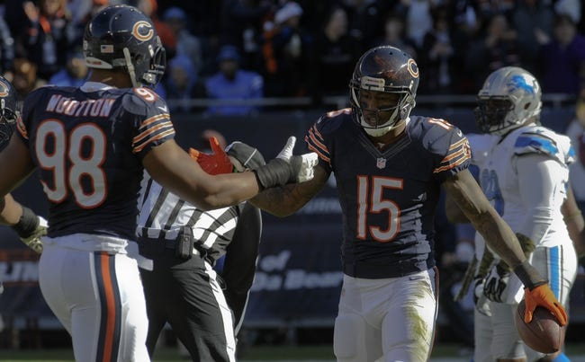 Nov 10, 2013; Chicago, IL, USA;  Chicago Bears defensive tackle Corey Wootton (98) celebrates with Brandon Marshall (15) after his touchdown during the game against the Lions at Soldier Field. Mandatory Credit: Matt Marton-USA TODAY Sports