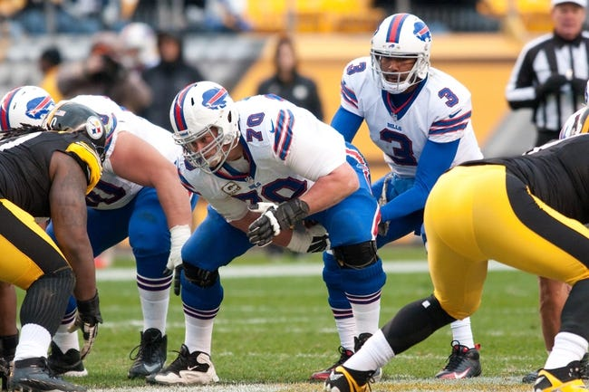 Nov 10, 2013; Pittsburgh, PA, USA; Buffalo Bills center Eric Wood (70) snaps the ball to quarterback EJ Manuel (3) during the third quarter of a game against the Pittsburgh Steelers at Heinz Field. Pittsburgh won the game 23-10. Mandatory Credit: Mark Konezny-USA TODAY Sports