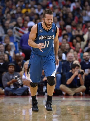 Nov 11, 2013; Los Angeles, CA, USA; Minnesota Timberwolves guard Jose Barea (11) celebrates after a 3-point basket against the Los Angeles Clippers at Staples Center. The Clippers defeated the Timberwolves 109-107. Mandatory Credit: Kirby Lee-USA TODAY Sports