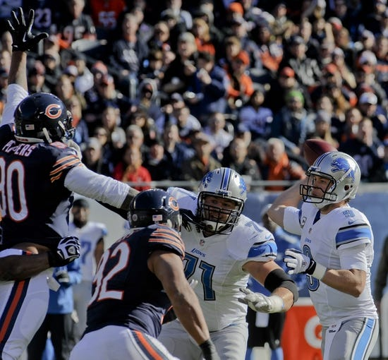 Nov 10, 2013; Chicago, IL, USA;  Detroit Lions quarterback Matthew Stafford (9) throws with coverage from Detroit Lions offensive tackle Riley Reiff (71) during the game against the Bears at Soldier Field. Mandatory Credit: Matt Marton-USA TODAY Sports