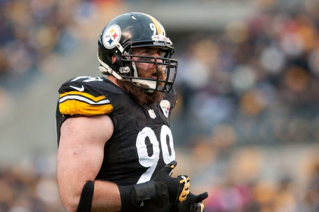 Nov 10, 2013; Pittsburgh, PA, USA; Pittsburgh Steelers defensive end Brett Keisel (99) looks at the scoreboard during the third quarter of a game against the Buffalo Bills at Heinz Field. Mandatory Credit: Mark Konezny-USA TODAY Sports