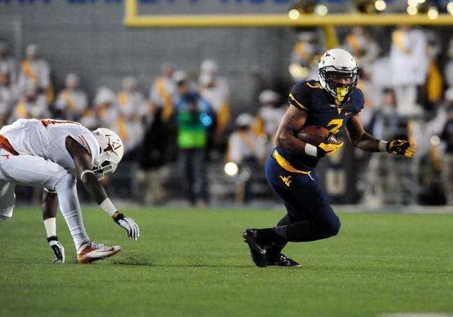 Nov 9, 2013; Morgantown, WV, USA; West Virginia Mountaineers running back Charles Sims (3) runs with the ball during the game against the Texas Longhorns at Milan Puskar Stadium. Mandatory Credit: Evan Habeeb-USA TODAY Sports