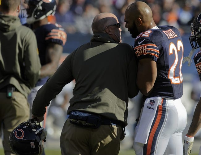 Nov 10, 2013; Chicago, IL, USA;  Chicago Bears running back Matt Forte (22) talks with a staff member during the game against the Lions at Soldier Field. Mandatory Credit: Matt Marton-USA TODAY Sports