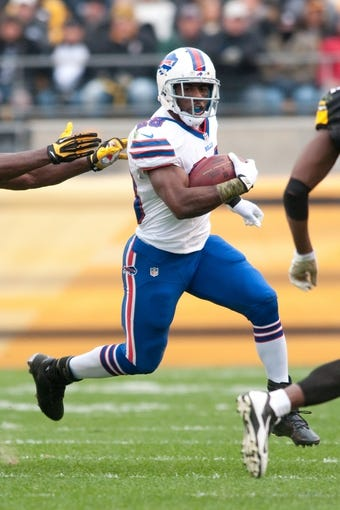 Nov 10, 2013; Pittsburgh, PA, USA; Buffalo Bills running back C.J. Spiller (28) runs around the end during the first quarter of a game against the Pittsburgh Steelers at Heinz Field. Mandatory Credit: Mark Konezny-USA TODAY Sports