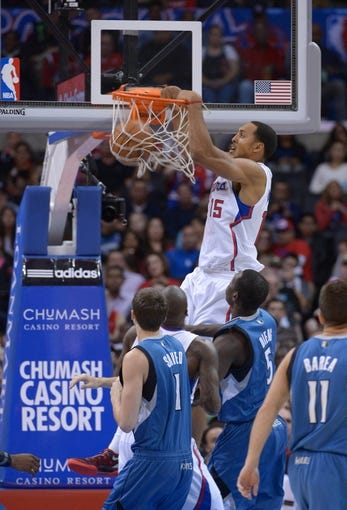 Nov 11, 2013; Los Angeles, CA, USA; Los Angeles Clippers center Ryan Hollins (15) dunks the ball against the Minnesota Timberwolves at Staples Center. Mandatory Credit: Kirby Lee-USA TODAY Sports