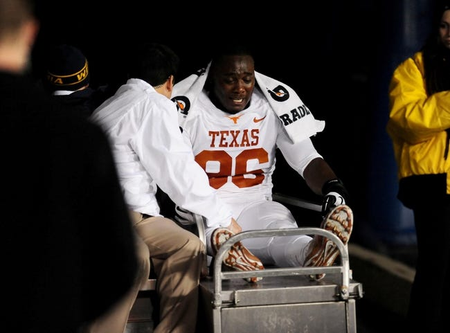 Nov 9, 2013; Morgantown, WV, USA; Texas Longhorns defensive tackle Chris Whaley (96) gets carted off the field during the game against the West Virginia Mountaineers at Milan Puskar Stadium. Mandatory Credit: Evan Habeeb-USA TODAY Sports
