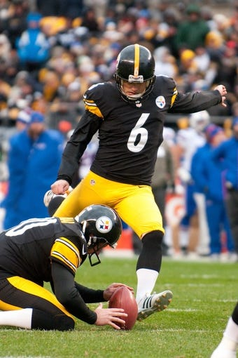 Nov 10, 2013; Pittsburgh, PA, USA; Pittsburgh Steelers kicker Shaun Suisham (6) kicks an extra point with punter Mat McBriar placing the ball during the third quarter of a game against the Buffalo Bills at Heinz Field. Pittsburgh won the game 23-10. Mandatory Credit: Mark Konezny-USA TODAY Sports