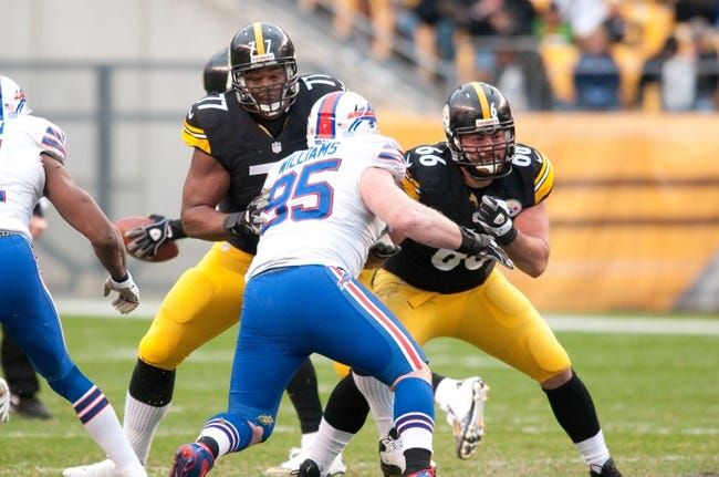 Nov 10, 2013; Pittsburgh, PA, USA; Pittsburgh Steelers guard David DeCastro (66) and tackle Marcus Gilbert (77) block Buffalo Bills defensive tackle Kyle Williams (95) during the second quarter of a game at Heinz Field. Mandatory Credit: Mark Konezny-USA TODAY Sports