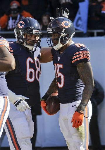 Nov 10, 2013; Chicago, IL, USA;  Chicago Bears guard Matt Slauson (68) celebrates with Brandon Marshall (15) after his touchdown during the game against the Lions at Soldier Field. Mandatory Credit: Matt Marton-USA TODAY Sports