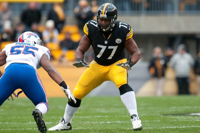 Nov 10, 2013; Pittsburgh, PA, USA; Pittsburgh Steelers tackle Marcus Gilbert (77) prepares to block Buffalo Bills outside linebacker Jerry Hughes (55) during the first quarter of a game at Heinz Field. Pittsburgh won the game 23-10. Mandatory Credit: Mark Konezny-USA TODAY Sports