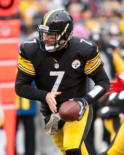 Nov 10, 2013; Pittsburgh, PA, USA; Pittsburgh Steelers quarterback Ben Roethlisberger (7) turns to make a hand off during the first quarter of a game against the Buffalo Bills at Heinz Field. Mandatory Credit: Mark Konezny-USA TODAY Sports