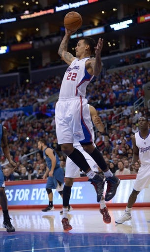 Nov 11, 2013; Los Angeles, CA, USA; Los Angeles Clippers forward Matt Barnes (22) rebounds the ball against the Minnesota Timberwolves at Staples Center. The Clippers defeated the Timberwolves 109-107. Mandatory Credit: Kirby Lee-USA TODAY Sports
