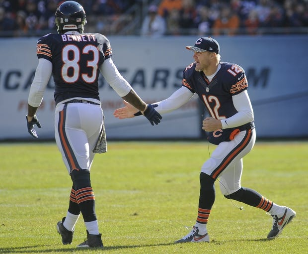 Nov 10, 2013; Chicago, IL, USA;  Chicago Bears tight end Martellus Bennett (83) gets support from quarterback Josh McCown (12) during the game against the Lions at Soldier Field. Mandatory Credit: Matt Marton-USA TODAY Sports