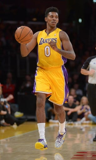 Nov 12, 2013; Los Angeles, CA, USA; Los Angeles Lakers guard Nick Young (0) dribbles the ball against the New Orleans Pelicans at Staples Center. The Lakers defeated the Pelicans 116-95. Mandatory Credit: Kirby Lee-USA TODAY Sports