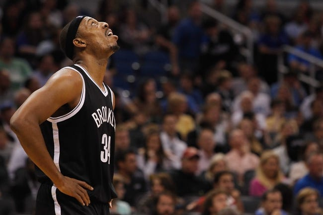 Nov 3, 2013; Orlando, FL, USA; Brooklyn Nets small forward Paul Pierce (34) looks up against the Orlando Magic during the second half at Amway Center. Mandatory Credit: Kim Klement-USA TODAY Sports