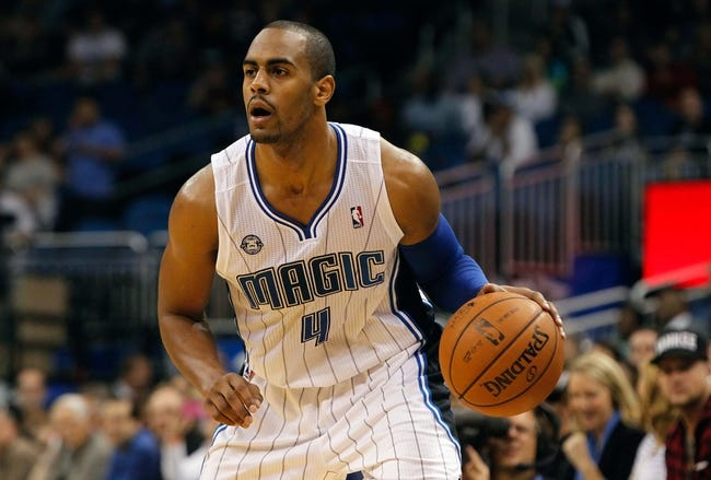 Nov 3, 2013; Orlando, FL, USA; Orlando Magic shooting guard Arron Afflalo (4) dribbles the ball against the Brooklyn Nets during the second half at Amway Center. Mandatory Credit: Kim Klement-USA TODAY Sports