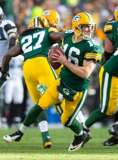 Nov 10, 2013; Green Bay, WI, USA; Green Bay Packers quarterback Scott Tolzien (16) during the game against the Philadelphia Eagles at Lambeau Field.  Philadelphia won 27-13.  Mandatory Credit: Jeff Hanisch-USA TODAY Sports