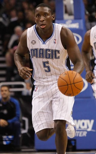 Nov 3, 2013; Orlando, FL, USA; Orlando Magic shooting guard Victor Oladipo (5) dribbles the ball against the Brooklyn Nets during the second half at Amway Center. Mandatory Credit: Kim Klement-USA TODAY Sports