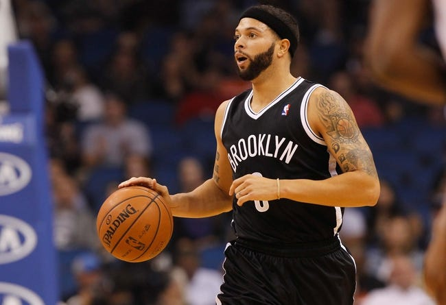 Nov 3, 2013; Orlando, FL, USA; Brooklyn Nets point guard Deron Williams (8) dribbles the ball against the Orlando Magic during the first quarter at Amway Center. Mandatory Credit: Kim Klement-USA TODAY Sports