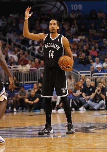 Nov 3, 2013; Orlando, FL, USA; Brooklyn Nets point guard Shaun Livingston (14) calls a play against the Orlando Magic during the first quarter at Amway Center. Mandatory Credit: Kim Klement-USA TODAY Sports