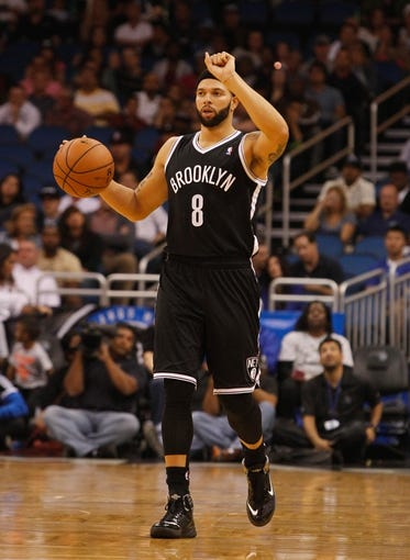 Nov 3, 2013; Orlando, FL, USA; Brooklyn Nets point guard Deron Williams (8) dribbles the ball against the Orlando Magic during the second quarter at Amway Center. Mandatory Credit: Kim Klement-USA TODAY Sports