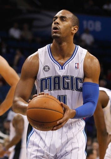 Nov 3, 2013; Orlando, FL, USA; Orlando Magic shooting guard Arron Afflalo (4) shoots a free throw against the Brooklyn Nets during the second half at Amway Center. Mandatory Credit: Kim Klement-USA TODAY Sports