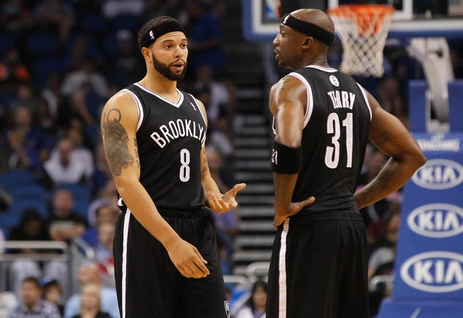 Nov 3, 2013; Orlando, FL, USA; Brooklyn Nets point guard Deron Williams (8) talks with shooting guard Jason Terry (31) against the Orlando Magic during the second quarter at Amway Center. Mandatory Credit: Kim Klement-USA TODAY Sports