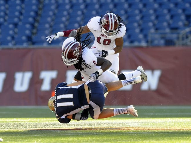 Nov 16, 2013; Foxborough, MA, USA; Akron Zips wide receiver Zach D'Orazio (11) is tackled by Massachusetts Minutemen defensive back Antoine Tharpe (2) and defense back Devin Brown (10) during the first half at Gillette Stadium. Mandatory Credit: Bob DeChiara-USA TODAY Sports