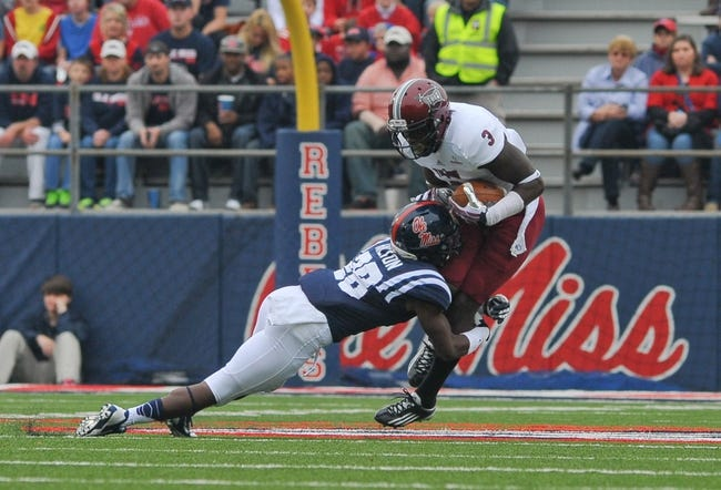 Nov 16, 2013; Oxford, MS, USA; Troy Trojans wide receiver Eric Thomas (3) is tackled by Mississippi Rebels defensive back Mike Hilton (28) during the first half at Vaught-Hemingway Stadium. Mandatory Credit: Justin Ford-USA TODAY Sports