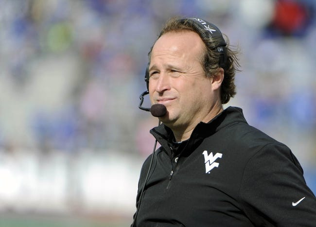Nov 16, 2013; Lawrence, KS, USA; West Virginia Mountaineers head coach Dana Holgorsen on the sidelines against the Kansas Jayhawks in the first half at Memorial Stadium. Mandatory Credit: John Rieger-USA TODAY Sports