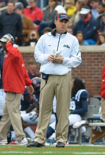 Nov 16, 2013; Oxford, MS, USA; Mississippi Rebels head coach Hugh Freeze during a timeout against the Troy Trojans during the first half at Vaught-Hemingway Stadium. Mandatory Credit: Justin Ford-USA TODAY Sports