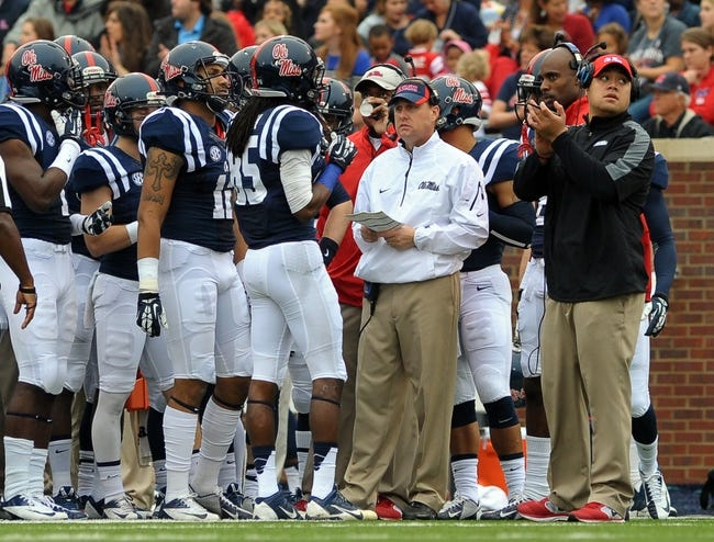 Nov 16, 2013; Oxford, MS, USA; Mississippi Rebels head coach Hugh Freeze talks to his team during a time out against the Troy Trojans during the first half at Vaught-Hemingway Stadium. Mandatory Credit: Justin Ford-USA TODAY Sports