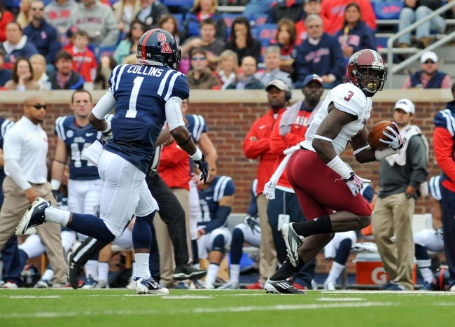 Nov 16, 2013; Oxford, MS, USA; Troy Trojans wide receiver Eric Thomas (3) moves the ball up field against the Mississippi Rebels during the first half at Vaught-Hemingway Stadium. Mandatory Credit: Justin Ford-USA TODAY Sports