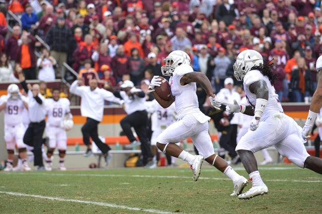Nov 16, 2013; Blacksburg, VA, USA; Maryland Terrapins defensive back William Likely (4) returns a punt for a touchdown as running back Kenneth Goins Jr. (30) looks on in the second quarter at Lane Stadium. Mandatory Credit: Bob Donnan-USA TODAY Sports