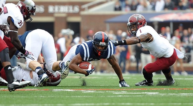 Nov 16, 2013; Oxford, MS, USA; Mississippi Rebels running back Jaylen Walton (6) is brought down by the Troy Trojans during the first half at Vaught-Hemingway Stadium. Mandatory Credit: Justin Ford-USA TODAY Sports