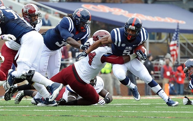 Nov 16, 2013; Oxford, MS, USA; Mississippi Rebels running back I'Tavius Mathers (5)  carries the ball against Troy Trojans during the first half at Vaught-Hemingway Stadium. Mandatory Credit: Justin Ford-USA TODAY Sports